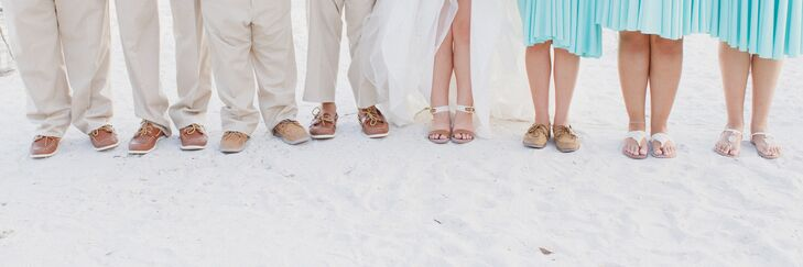 The bridesmaids wore sea-foam colored knee length wrap dresses and sandals, except for Jessica's sister who wore Sperry boat shoes.