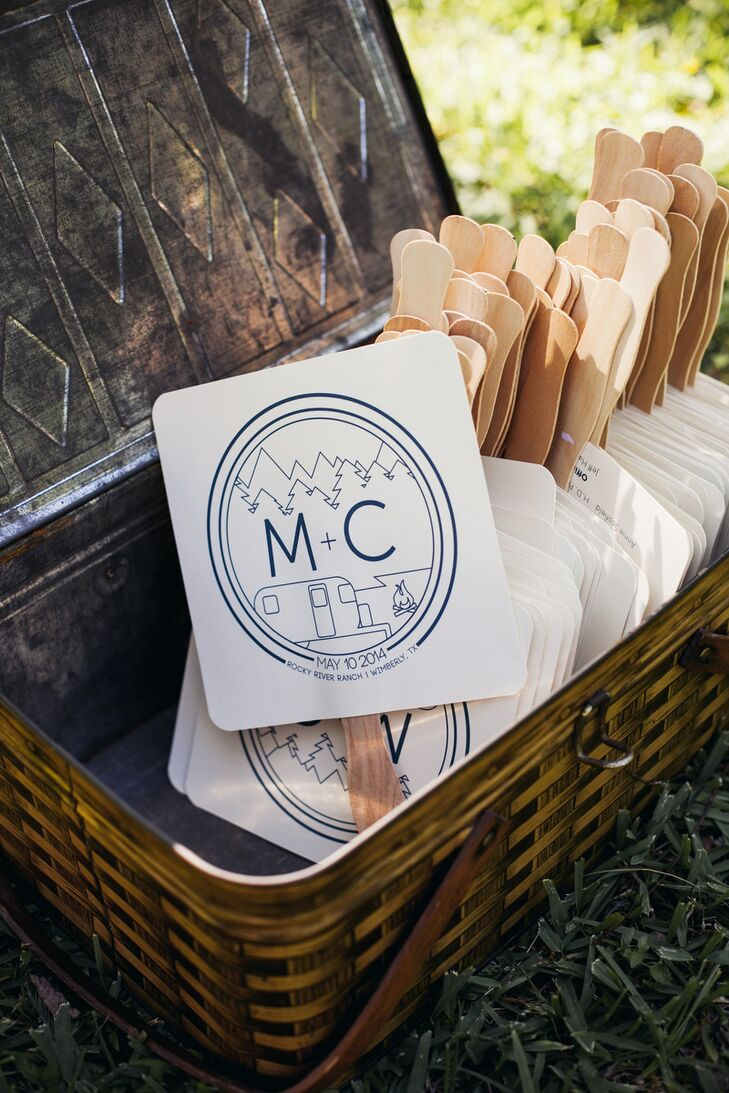 The couple created much of their decor themselves to put as much of their styles and personalities into their wedding. Mark designed the stationery—including program fans for the outdoor ceremony—with a cute custom M + C logo reminiscent of summer camp.