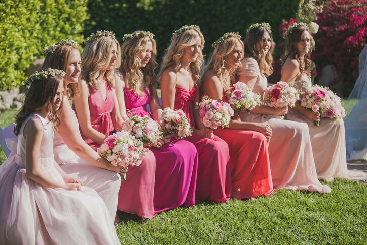 The bridesmaids wore their own dresses in various shades of pink. Romantic flower crowns completed the look.
