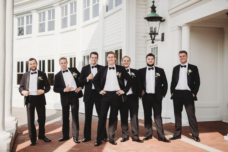 Groom and Groomsmen in Classic Black Tuxes and Bow Ties