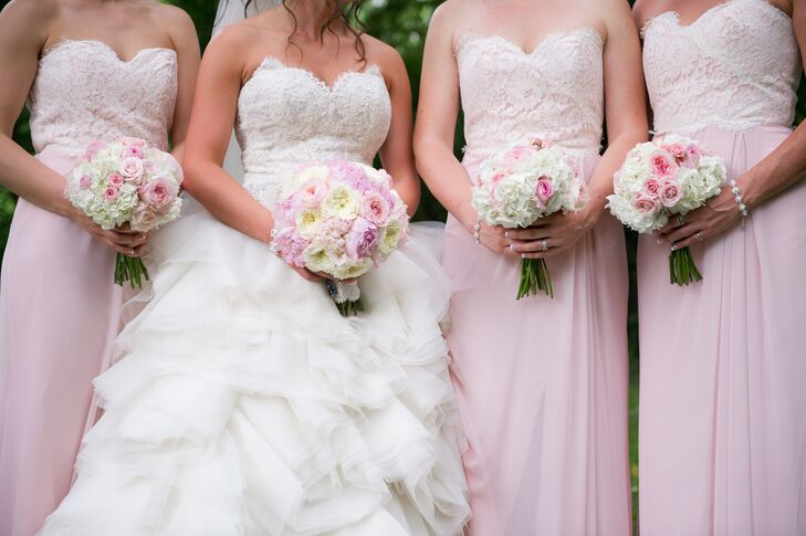 The bride carried blush and ivory garden roses and peonies and the bridesmaids carried blush roses with white hydrangeas in their bouquets.