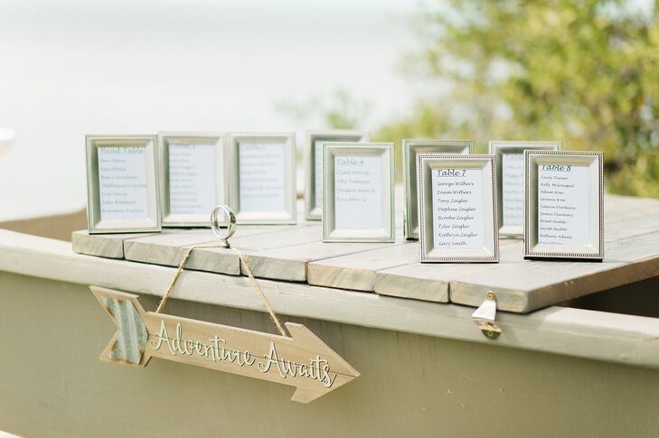 In lieu of escort cards, a seating chart was made using silver frames.