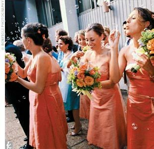 Mandy's six attendants (four bridesmaids and two maids of honor) chose their own style of dresses by Saeyoung Vu Couture. The bridesmaids wore orange dresses with sorbet details, while the maids of honor wore sorbet with orange details.