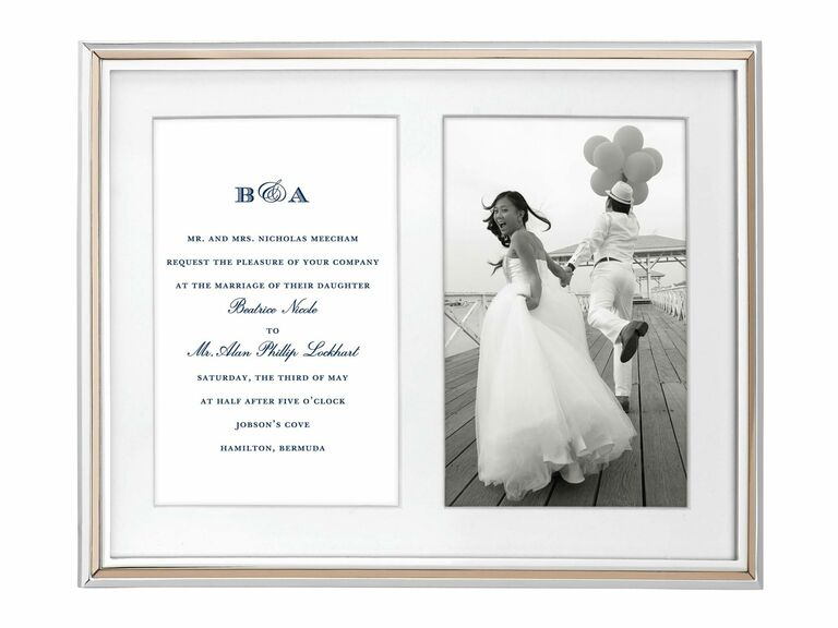 picture frame holding wedding invitation and wedding photo