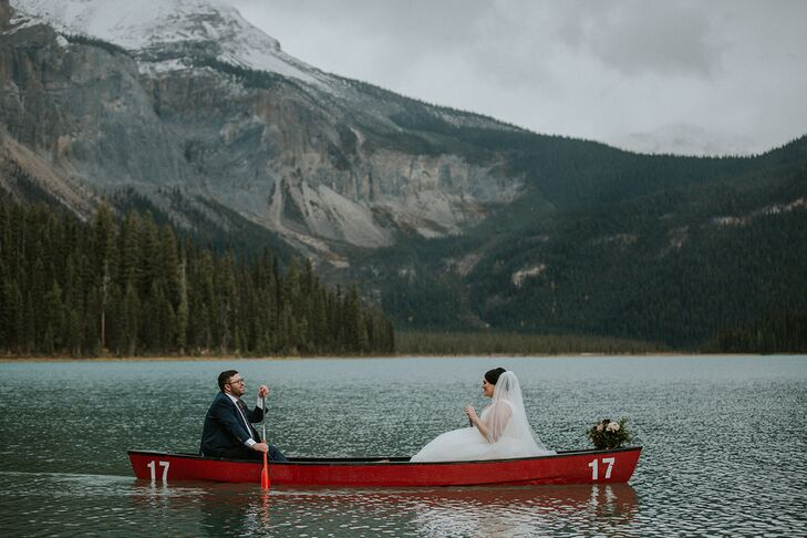 Elegant Couple in Canoe with Lake, Mountains and Trees