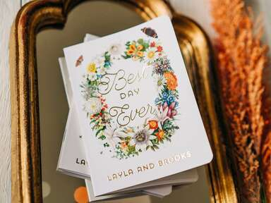 floral vow books with gold foil writing
