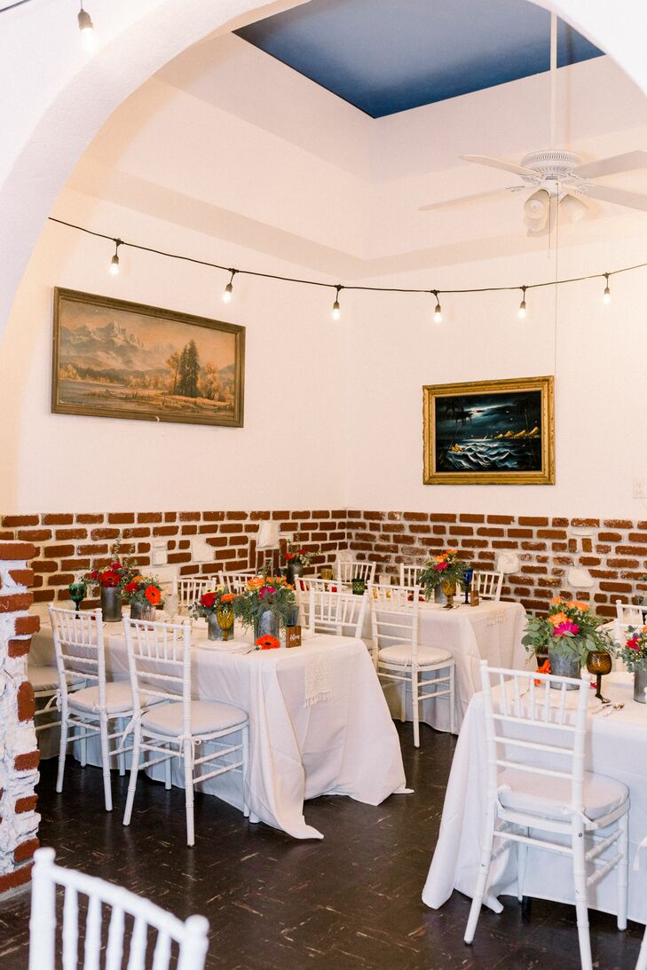 Casual Reception with White Tables and Brick Walls