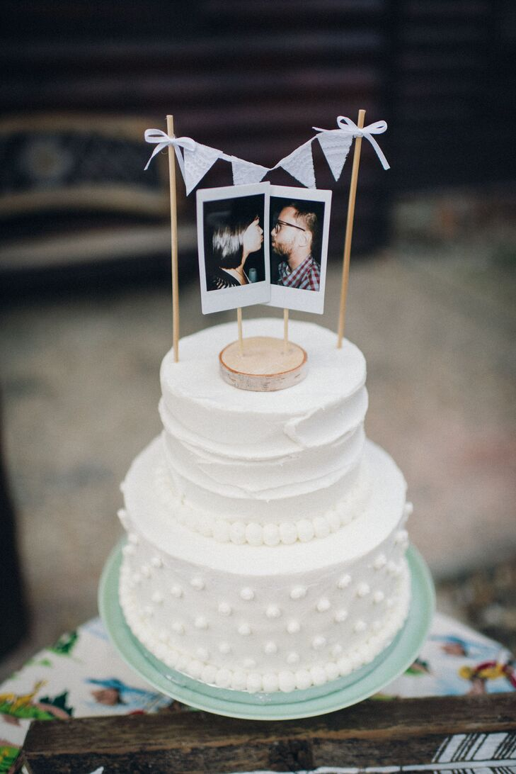 Namia and Jared had a vintage-inspired cake with the same polka-dot motif as Namia's dress. The topper was a pair of Polaroid pictures of Namia and Jared surrounded by mini pennant flags.