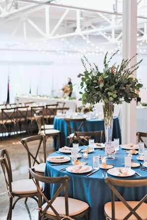 Dining Table with Cross-Back Chairs, Blue Linens and Tall Centerpieces