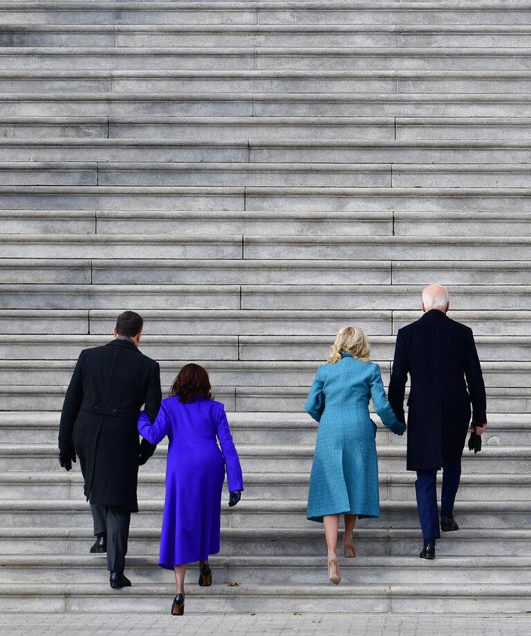 President Joe Biden (R), wife Jill Biden (2nd R), U.S. Vice President Kamala Harris (2nd L), and husband Douglas Emhoff (L) arrive for the 59th Presidential Inauguration