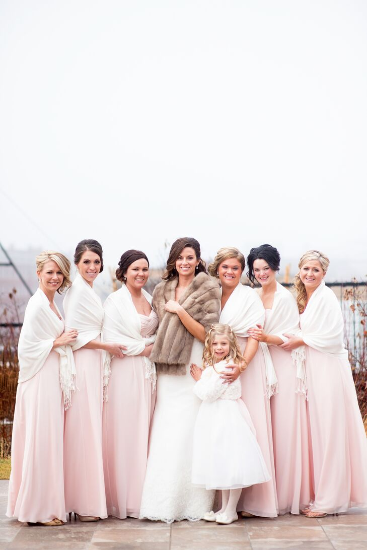 Each of Kelsey's six bridesmaids paired their blush, floor-length gowns with white pashminas for a look that was quintessential winter glam.