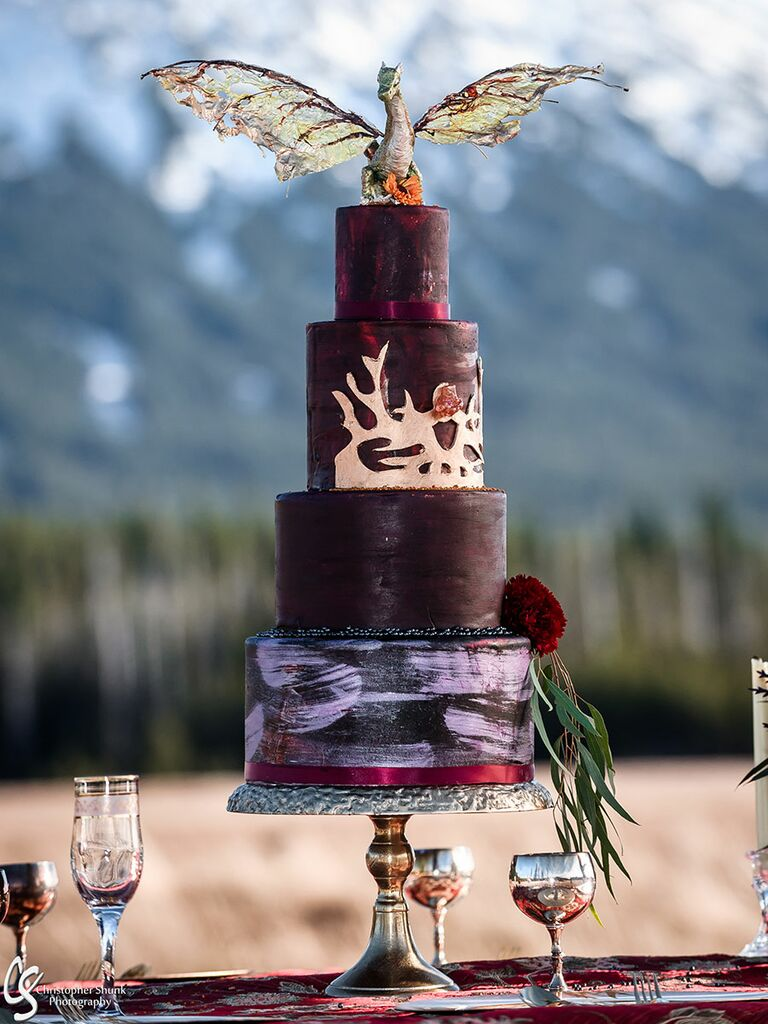Game of Thrones–inspired wedding cake with dragon cake topper
