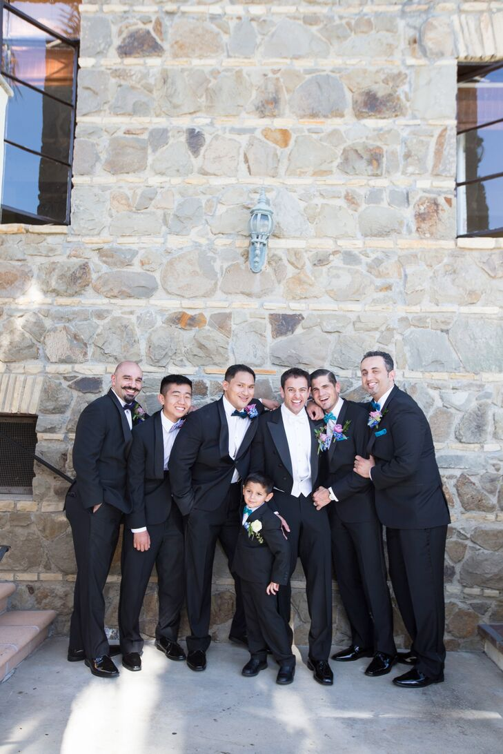 To match the day's elegant, formal feel, Ali and his groomsmen wore classic black tuxedos.