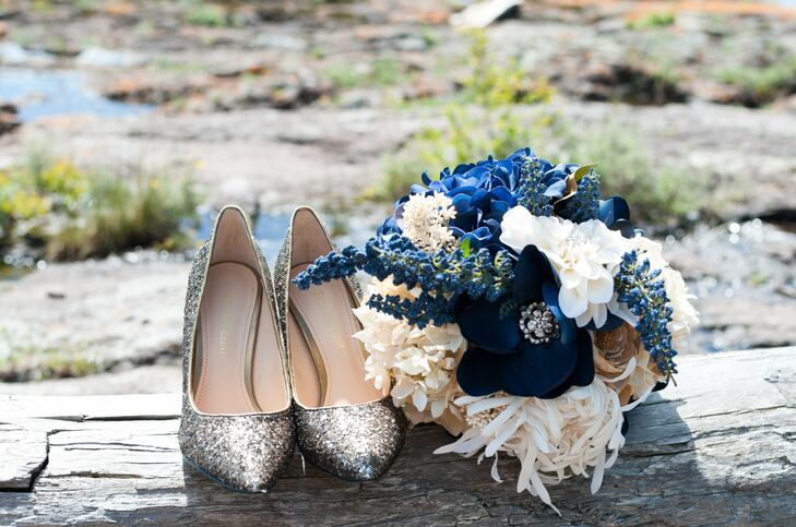 The bride carried a navy and white silk flower bouquet that she now displays in her home. The bridesmaids bouquets were silk ivory bunches that her friends were also able to keep.