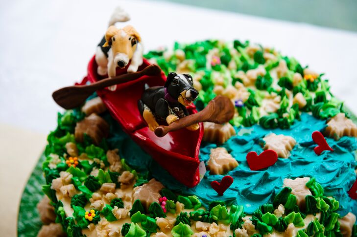 Inspired by the Vermont-focused fete, Irene's Cakes by Design created a one-of-a-kind confection for Jess and Todd's groom's cake. The maple-flavored cheesecake displayed a typical Green Mountain scene—the couple's dogs, Echo and Claudine, paddling down the Batten Kill River in a canoe.