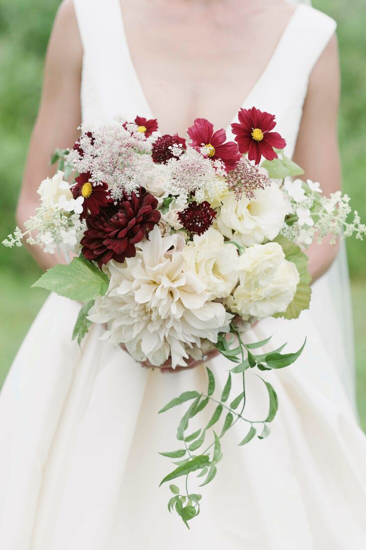 Michele's bouquet was a textured mix of full, soft blooms, including dahlias and lisianthus, accented with wildflowers, scabiosa and cascading vines. Arranged by GBC Style Flowers, the bouquet captured the untamed elegance of Blooming Hill Farm's rural landscape.