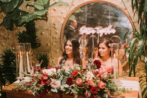 Rustic Sweetheart Table with Red Flower Arrangements