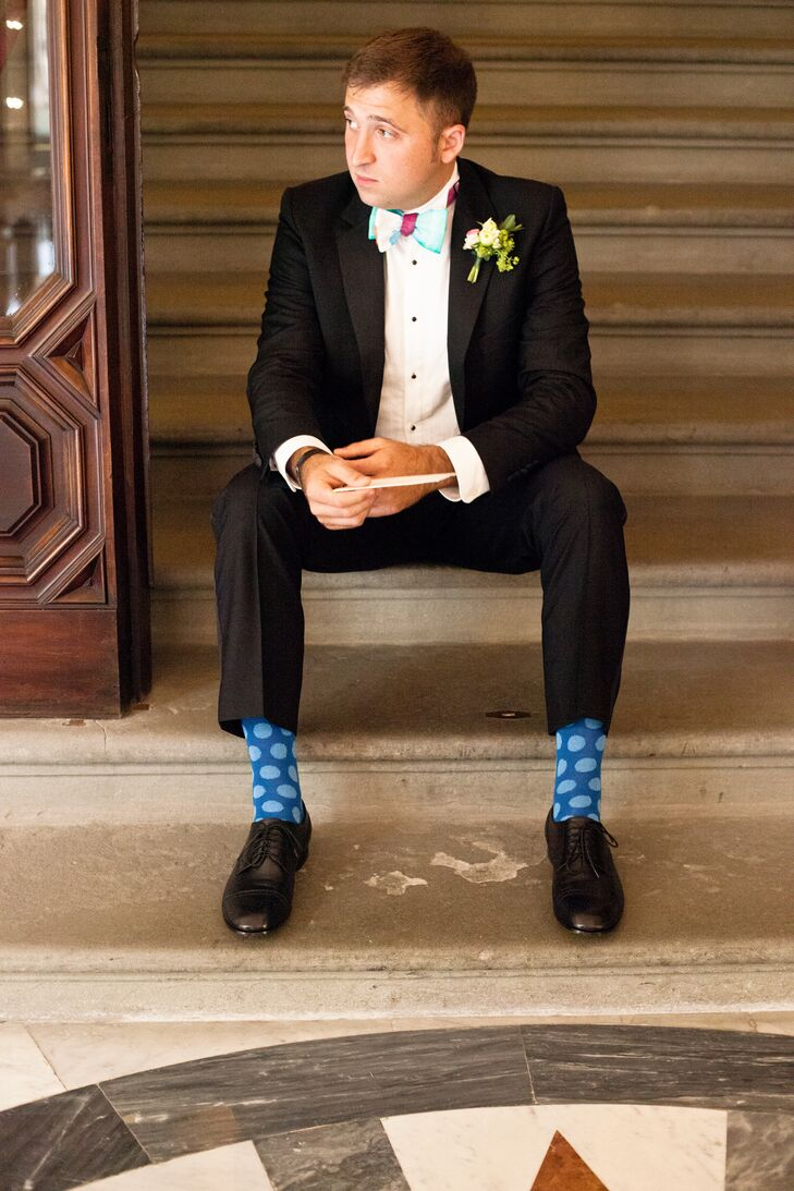Solomon wore a black tuxedo by Duchamp London and playful blue polka-dot socks. He also wore a colorful House of Perna bow tie that Amanda created.