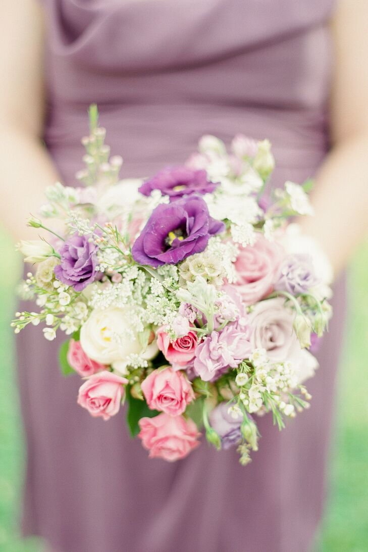 The bridesmaids' bouquets complemented their dresses and consisted of roses, waxflowers and other assorted flowers in a palette of pink, purple and ivory.