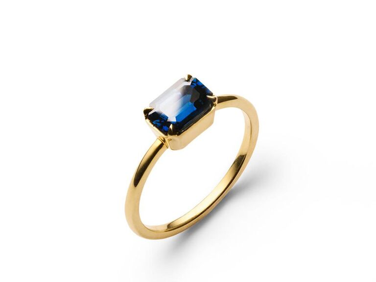 Blue sapphire engagement ring on gold band