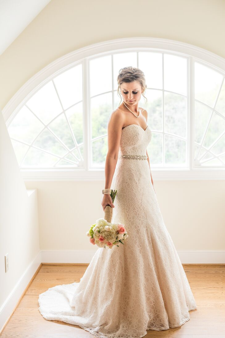 When it came to choosing her wedding dress, Jordan headed to Patina in Roanoke. It was there that she spotted the perfect gown for rustic chic outdoor affair — a lace mermaid gown by Mori Lee. The lady-like silhouette had an ultra flattering fit and the delicate lace overlay lent the gown a touch of timeless, feminine flair. Jordan completed her wedding look with a shimmery crystal sash, which she tied around the waist, a pearl bracelet belong to her sister, a pearl necklace and a rose-shaped ring that had once belonged to her grandmother.