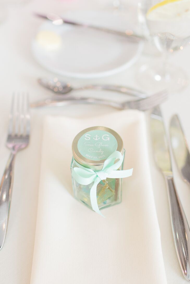 As a thank you to their friends and families for being present to celebrate their marriage, Gina and Steven sent guests home with jars filled with locally made sweets. The pint-sized vessels boasted colorful homemade sea glass candy and were decorated with personalized mint labels and dainty pastel bows.