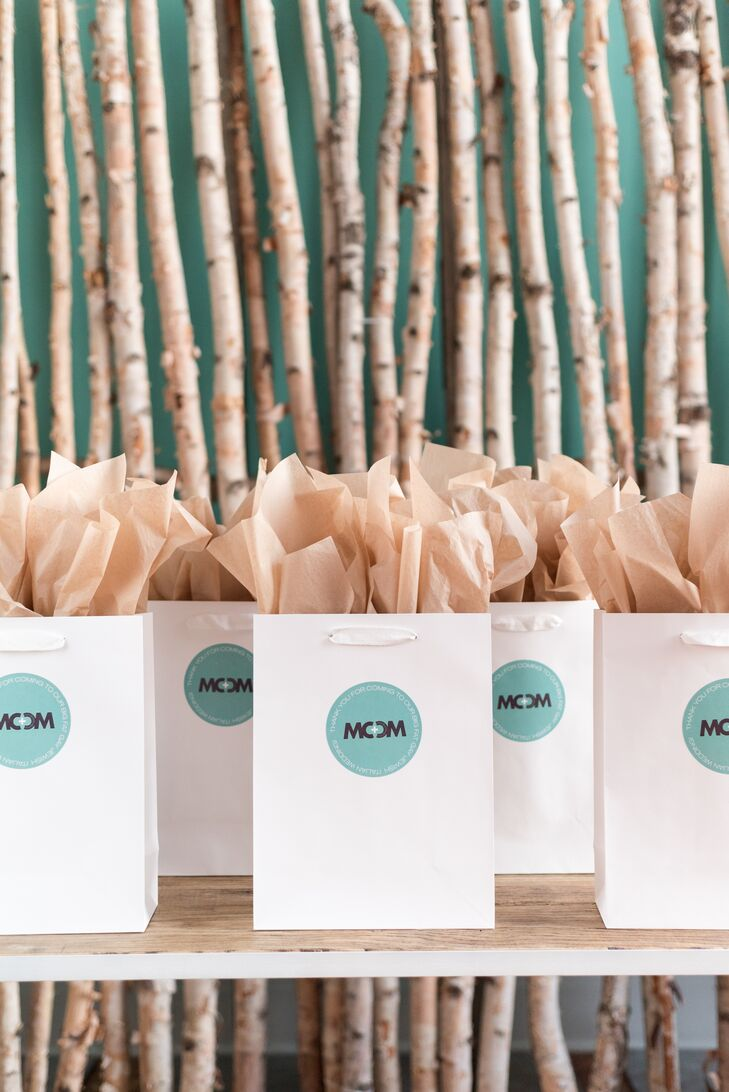 Included with the knit-hat favors were monogrammed gift bags containing two end-of-the-night treats to honor the grooms' backgrounds: mini rugelach for Michael and mini cannoli for Mike.