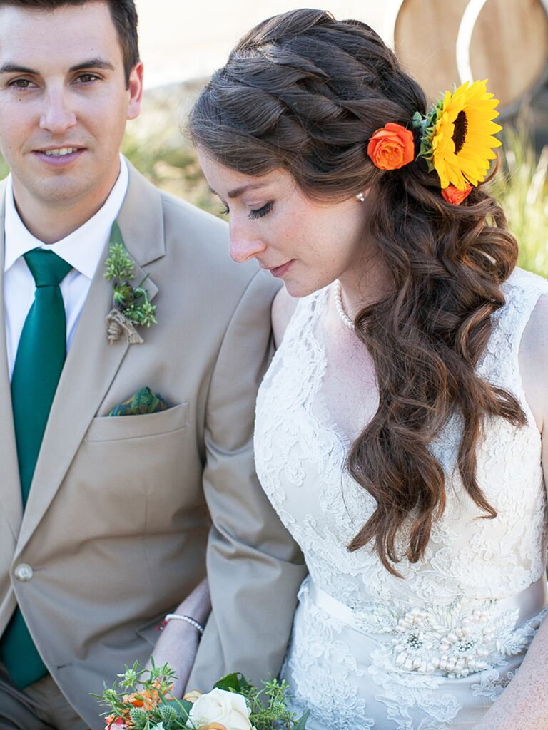 Long curled wedding hairstyle with flowers