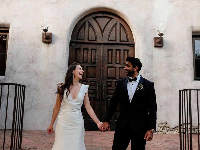 Couple holding hands and laughing
