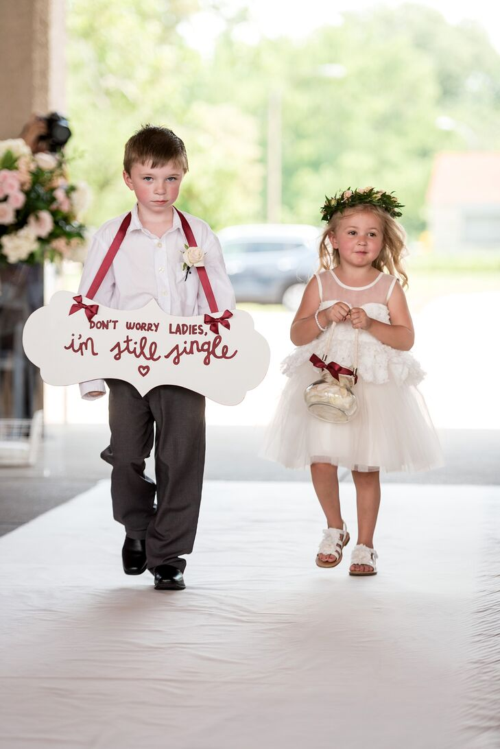 "The ring bearer wore a sign reading, ""Don't worry, ladies. I'm still single."""