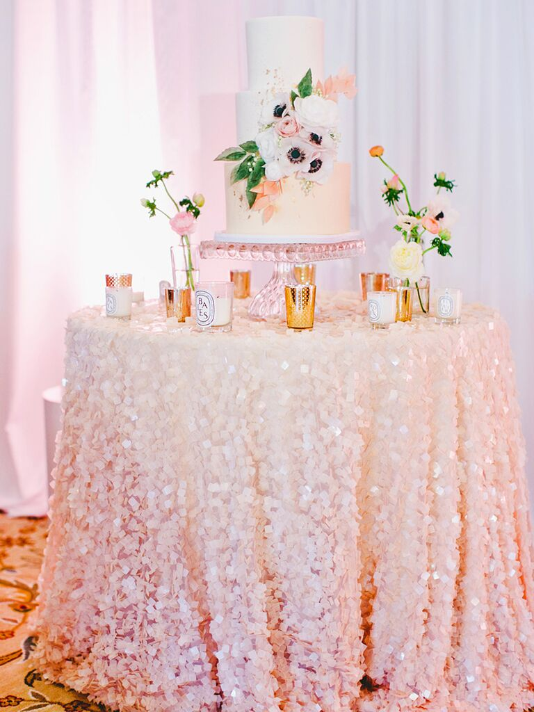 Light pink sequin table linen for a wedding cake dessert table