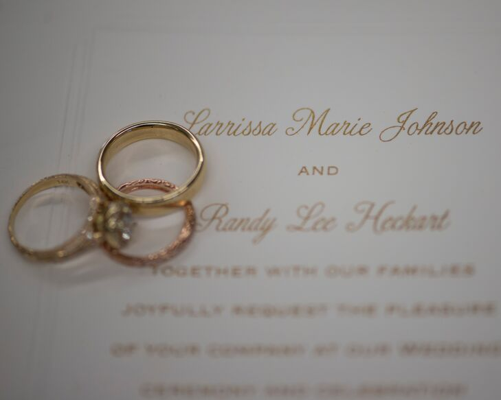 The classic wedding invitations were white paper with gold calligraphy writing.