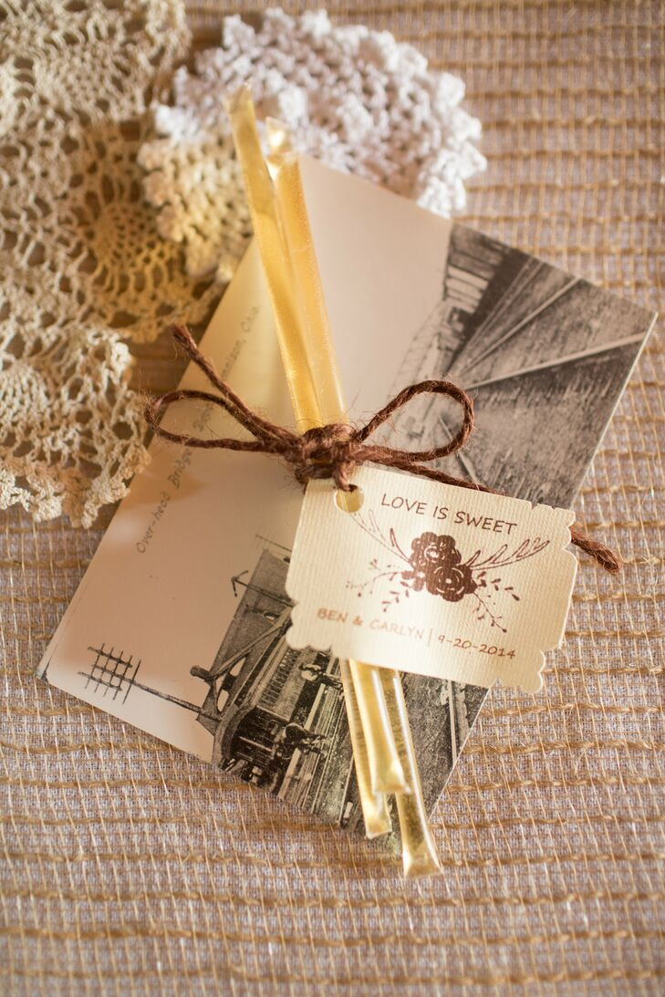 """""""Our last name is Pecchia, which is Italian for 'bumblebee,' so we thought the honey sticks were a fun way to incorporate another personal touch,"""" Carlyn says. Leather string tied together the honey sticks, tagged with a label that read """"Love is Sweet."""""""