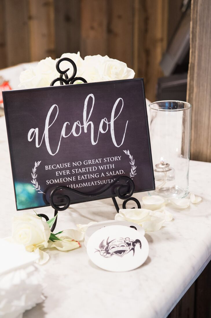 "Near the reception's bar, printed white calligraphy on elegant black signs explained ""No great story ever started with someone eating a salad."""