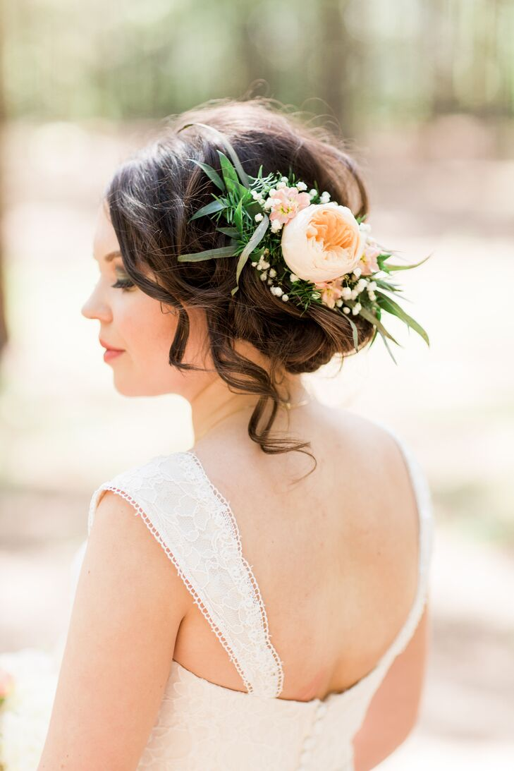 """My sweet friends told me to do something natural but different—take his breath away,"" Karley says of her romantic updo, which included live flowers and greenery."