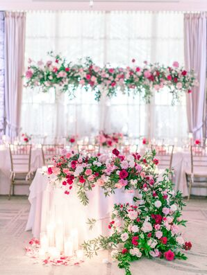 Romantic Pink Sweetheart Table with Cascading Rose Arrangement