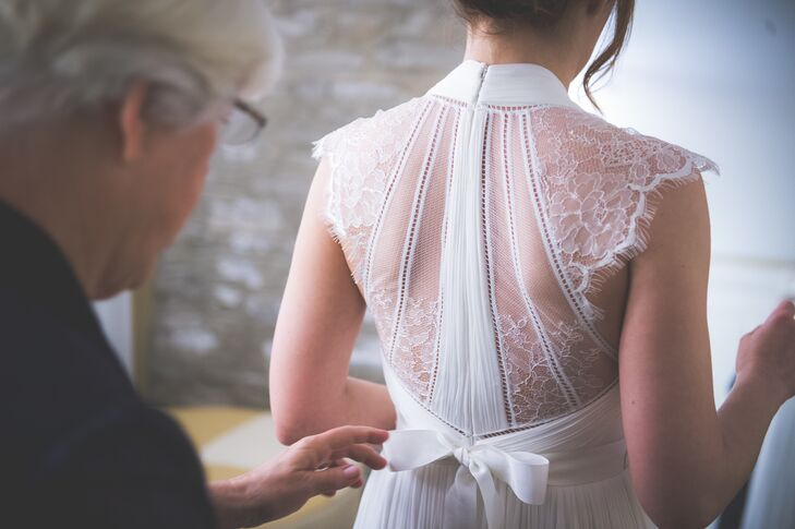 Rebecca wore an ivory wedding dress that was accented with lace on the sleeves and on the entire back. The dress elegantly was tied with ribbon on the back.