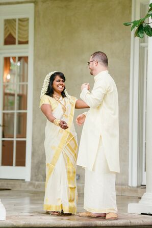 Bride Showing Gold and White Sari During First Look