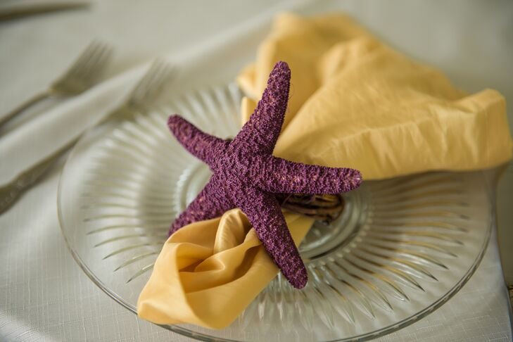 Purple bows were added to each chair and purple starfish napkin holders popped against yellow napkins.