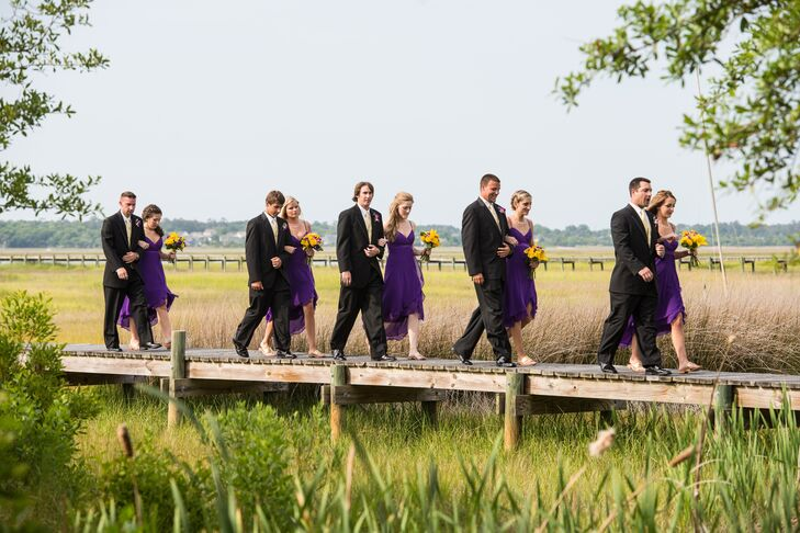 The bridesmaids wore short purple dresses with gold flats and the groomsmen had yellow vests to complement the plum and mustard color palette.
