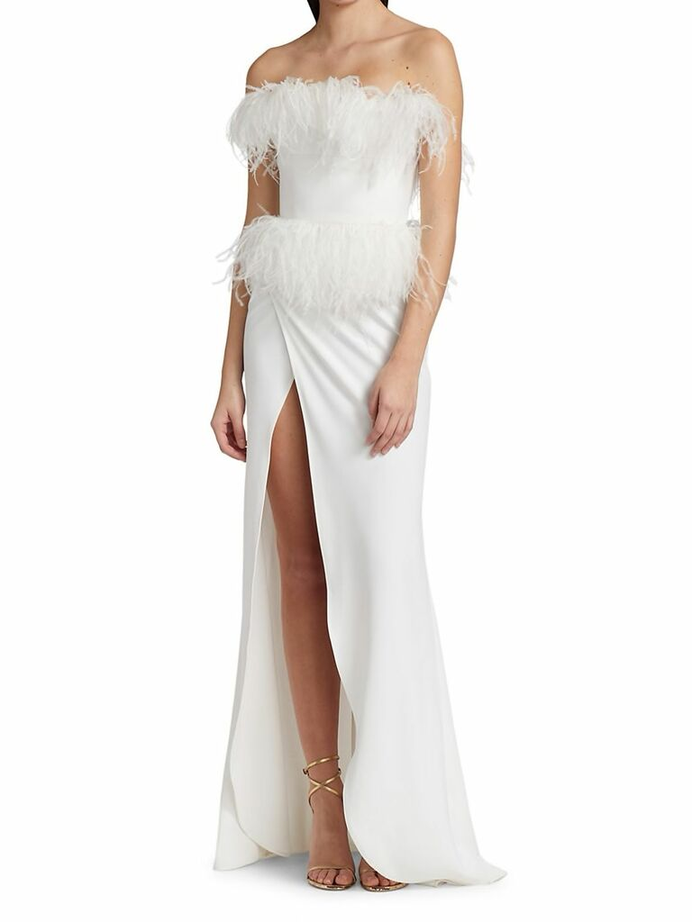 strapless crepe gown with high slit and ostrich feather trim