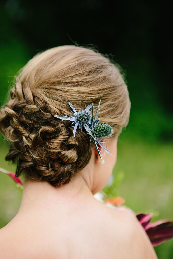 Jessica's natural updo was accented with blue thistle, a reoccurring motif in the wedding.