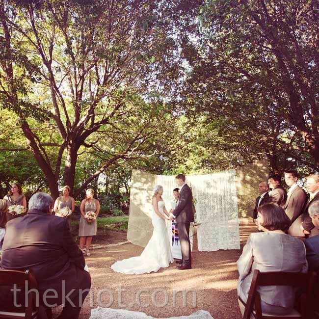 Lace and burlap curtains strung from two trees became a backdrop for Shawna and Matt's vows.