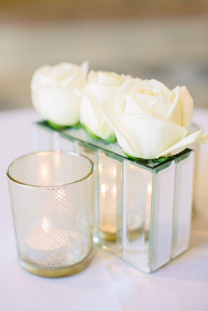 Simple White Rose Centerpiece in Mirrored Vase