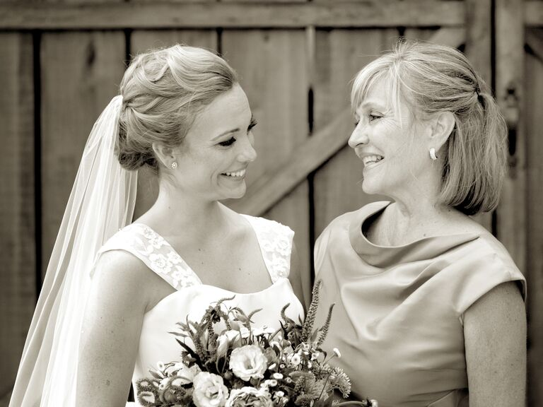 Bride smiling at mom on wedding day