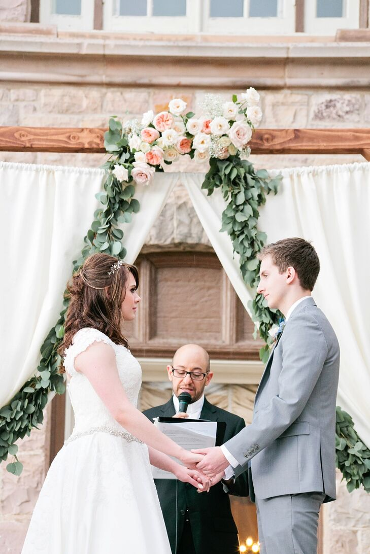"Brittany's dad built the ceremony arch, stained to the perfect color. Chiffon drapes were added, then the florist decorated the arch with garden greenery and flowers. To personalize the ceremony, the couple went with a play on Nick's last name and nickname, ""Link."" The officiant spoke about them ""joining and connecting their lives together,"" demonstrated by Brittany and Nick ""linking"" pieces of paper that featured their handwritten vows, similar to a countdown-to-Christmas paper chain. Guests wrote their own messages to the bride and groom on strips of paper and linked onto Nick and Brittany's chain. ""Eventually we ended up with a big chain that we can place on our fireplace mantel or Christmas tree during the holidays,"" Brittany says."