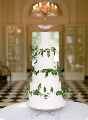 Sophisticated Buttercream Cake with Greenery and Decorative Linear Piping