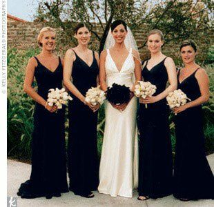 Laura's four bridesmaids wore deep plum sheath gowns from Lazaro.