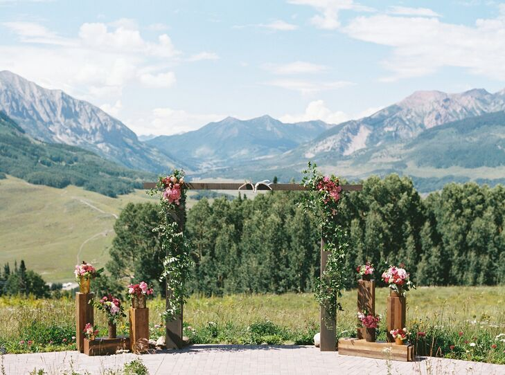 """The decor simply highlighted the natural beauty of the surroundings we were in,"" Anne Marie says. The pair designed an arbor overlooking the East River Valley for the spot where they said their vows."