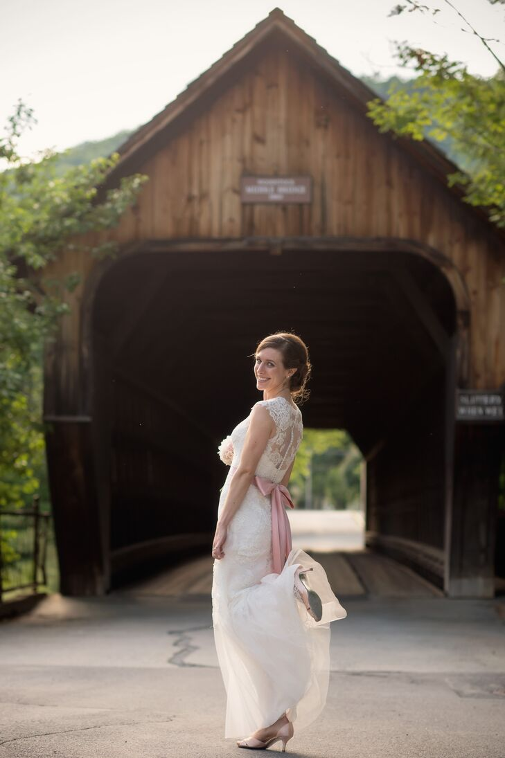 """""""For the reception, I wanted to switch into a fun and airy dress,"""" says Nellie. After the ceremony, she shed her grandmother's vintage wedding dress in favor of a more modern, A-line gown by Monique Lhuillier."""
